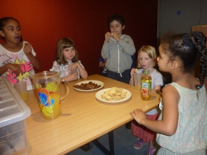 The children enjoying their biscuit and squash break.